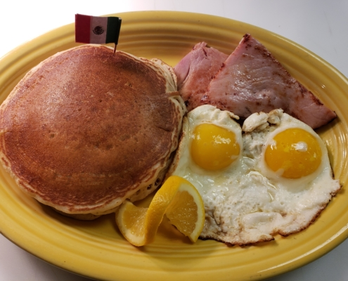 Pancakes Fried Eggs and Ham for breakfast at Buena Vista Kitchen